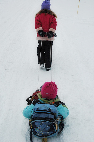 Emma pulls the sled